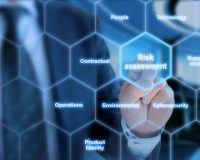Different risk types in a hexagon grid touched by a business analyst in a blue suit